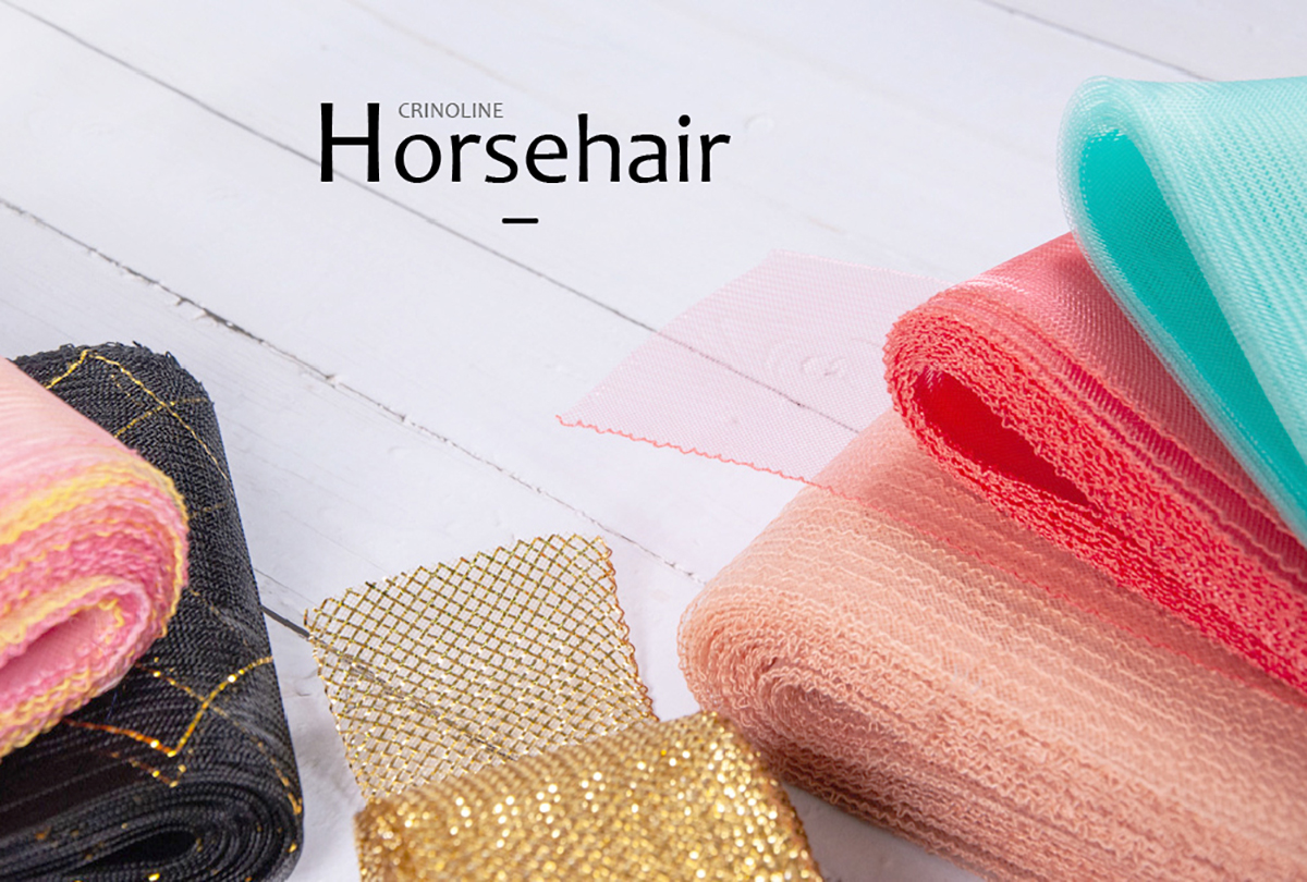 Crinoline, also know as horsehair fabric, is a net-like material that is durable, easily shaped, and often used in decorating clothing, hats, and accessories.